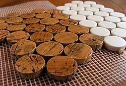 prototype cork tile discs beside production ceramic tile discs